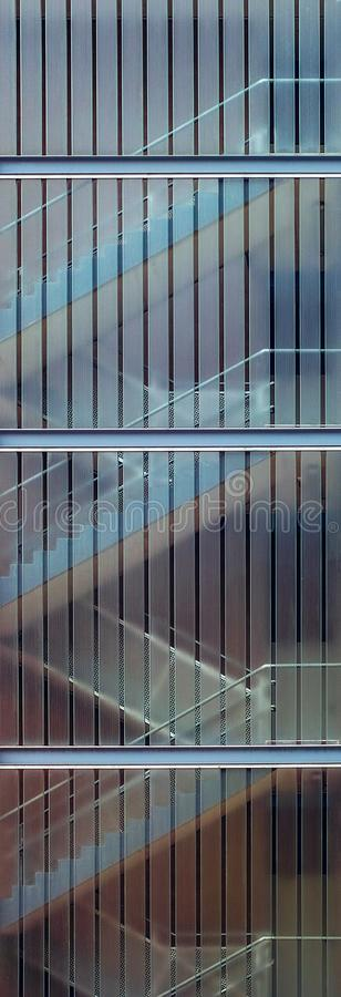 The stairs behind the windows royalty free stock photos