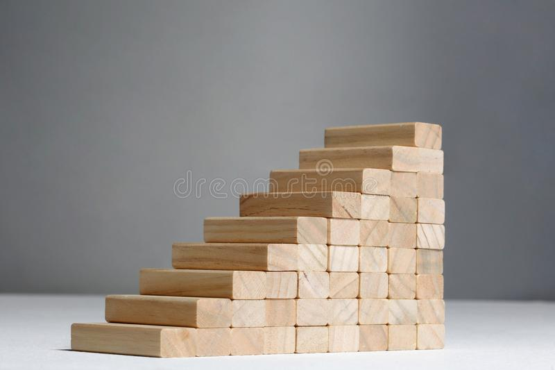 Stairs to success build with wooden blocks on grey background with copy space. Stairs build with wooden blocks on grey background royalty free stock photography