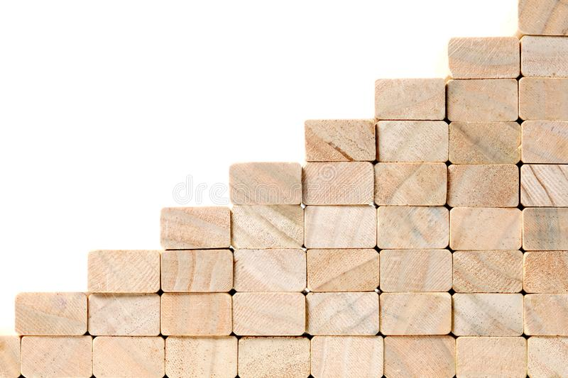 Stairs to success build with wooden blocks on grey background with copy space royalty free stock photography