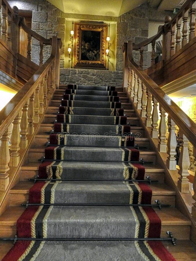 Stairs of a castles or palaces with carpets in stairs. Up stairs of a castles or palaces with carpets in stairs stock image
