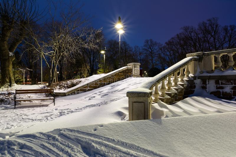 Stairs covered with snow in Burgas Sea Garden, Bulgaria. Winter blue hour landscape.  royalty free stock image