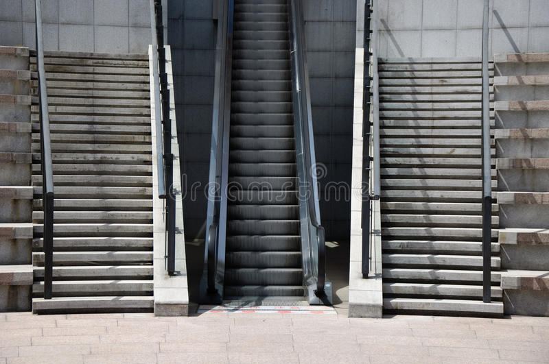 Stairs and elevator fast or slow stock images