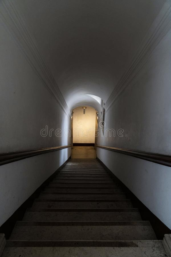 Stairs going down to the exit royalty free stock photo