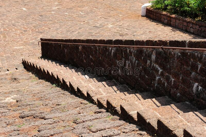 Stairs made of red stones in an ancient architectural complex. Stone steps close-up. Historical heritage, architectural monuments.  stock image
