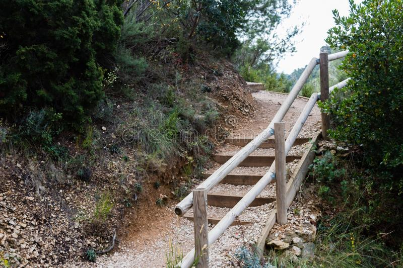 Rock stairs to trek the hill with wooden reiling. Stairs made of rocks and wood to trek the hill with wooden reiling stock photography