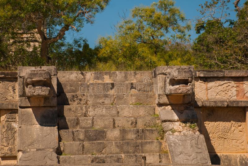 Stairs and Mayan sculpture on the corners. Ancient Mayan city. Chichen-Itza, Mexico. Yucatan. Stairs and Mayan sculpture on the corners. Ancient Mayan city stock image