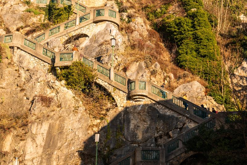 Stairs named schlossbergstiege up to landmark schlossberg with clock tower uhrturm in Graz, Austria royalty free stock photos