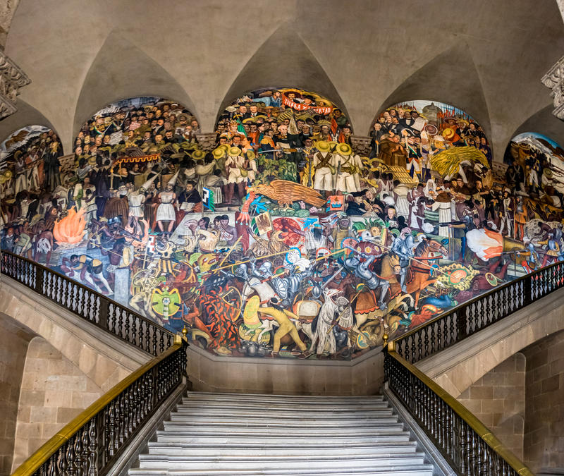 The stairs of national palace with the famous mural the for Diego rivera la conquista mural