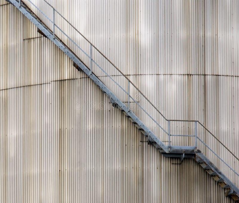 Stairs on oil silo royalty free stock photos