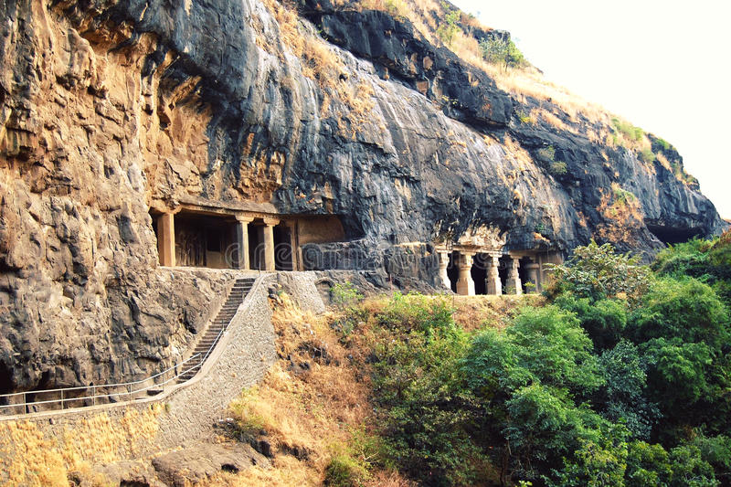 Stairs into the one of Ellora Caves. Aged photo. stock image