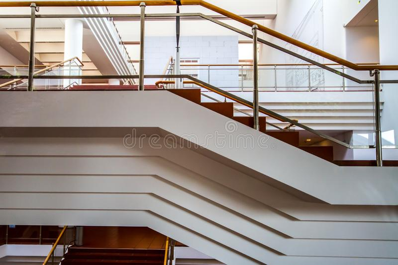 Stairs and other geometric forms in an interlaced building. Structures and patterns stock image