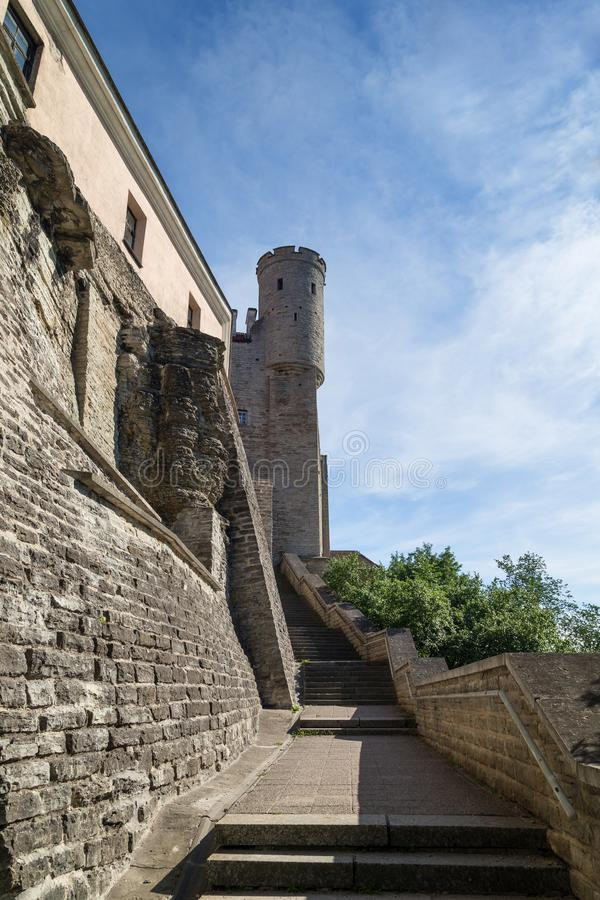 City wall at the Old Town in Tallinn. Stairs outside the medieval city wall or Town Wall or Walls of Tallinn and a tower on Toompea Hill at the Old Town in stock photography