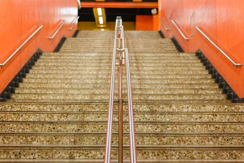 Stairs and railing in the underground passage subway. Exit to the city stock photo