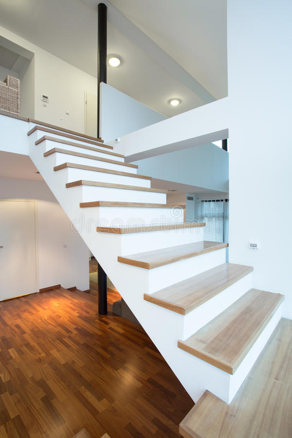 Stairs without rails. High wooden stairs without rails leading to the first floor royalty free stock image