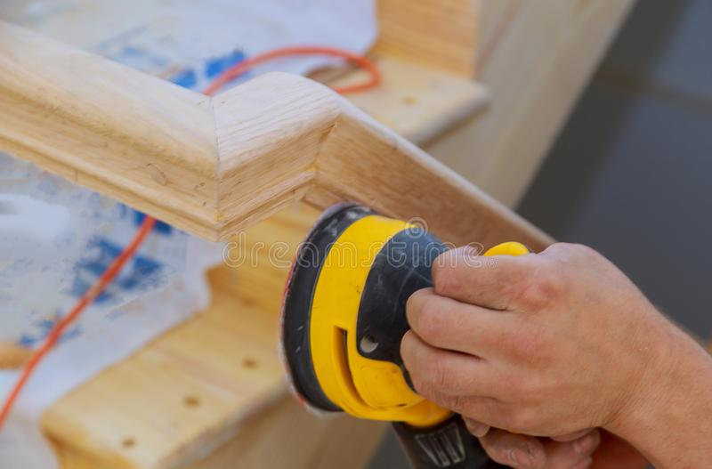 Stairs renovtion handrails renovation sander for wooden handrails. Stairs sander for wooden handrails renovation a new house under construction sanding stairway royalty free stock photos