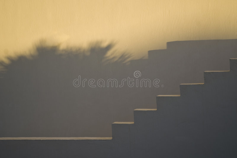 Stairs and shadows at sunset royalty free stock image