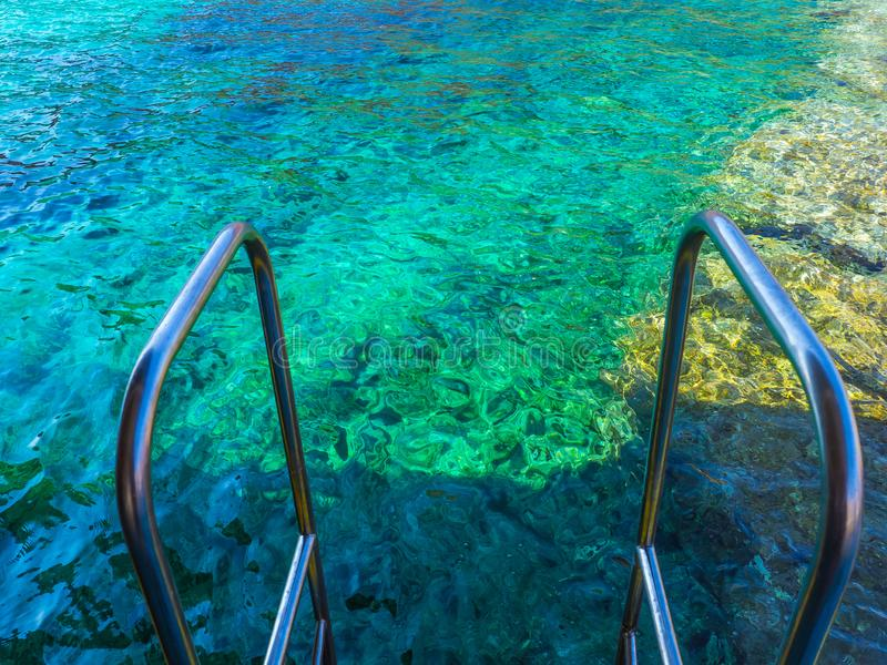 On the stairs of the ship - about to enter crystal clear waters of Crete, Greece stock photo