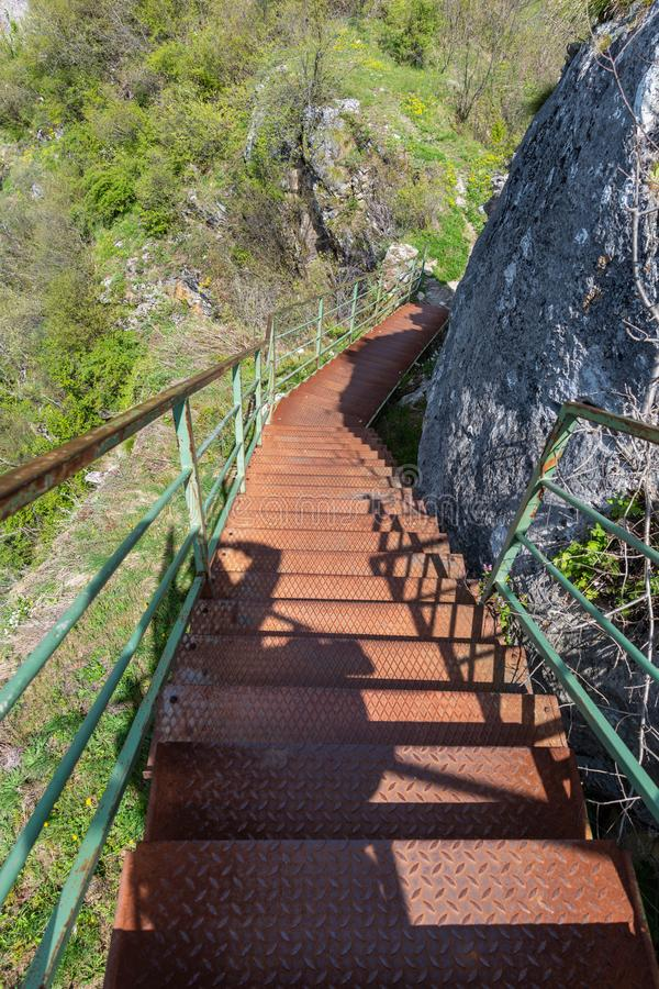Stairs from steel to the top of the mountain. At the edge of the cliff. royalty free stock photography