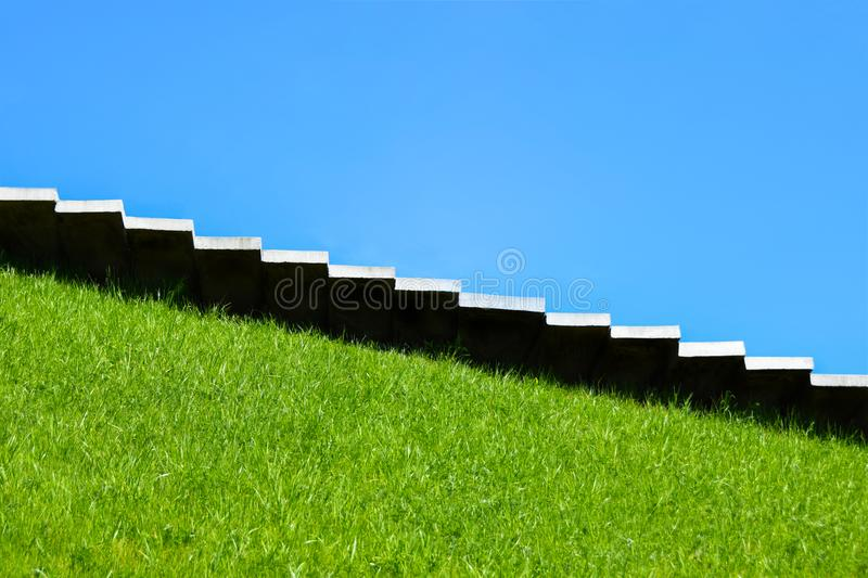 Stairs, steps up, steps down, growth, fall, climb uphill, achievement, nature, career, mound, monument, copy space, background royalty free stock photography