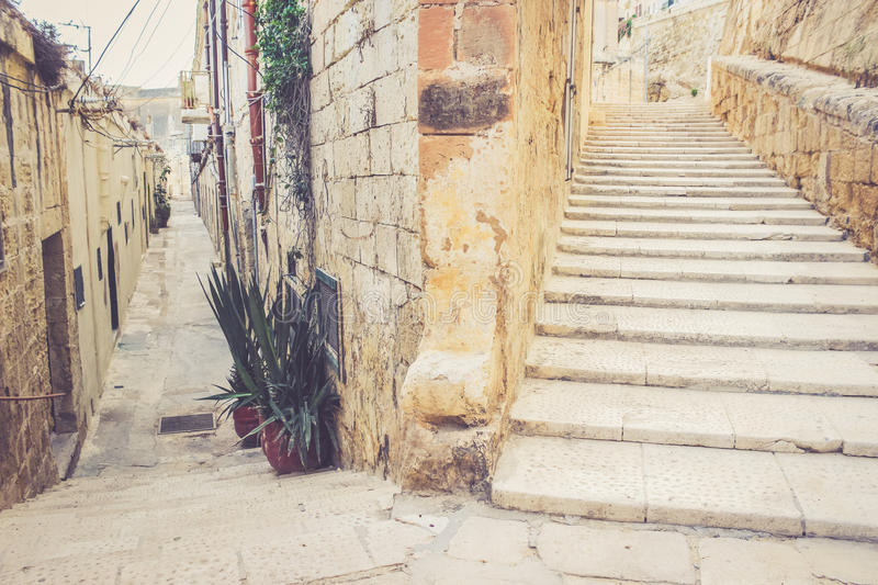 Stairs on the street of la Valletta. Malta. Two different ways to choose. Moving up to Success concept stock image