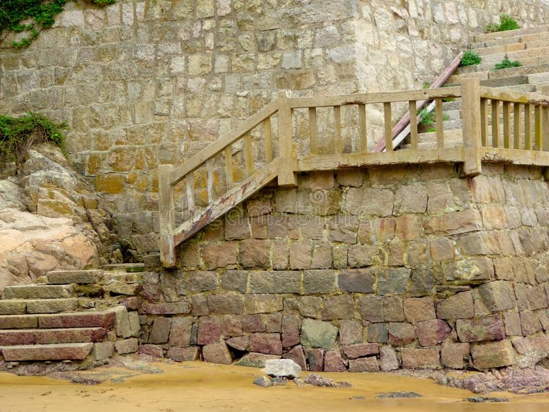 Stairs on Thousand step sand beach. A weathered stairs to the watch view tower on Thousand step sand beach in Mount Putuo zhoushan city zhejiang province China stock images