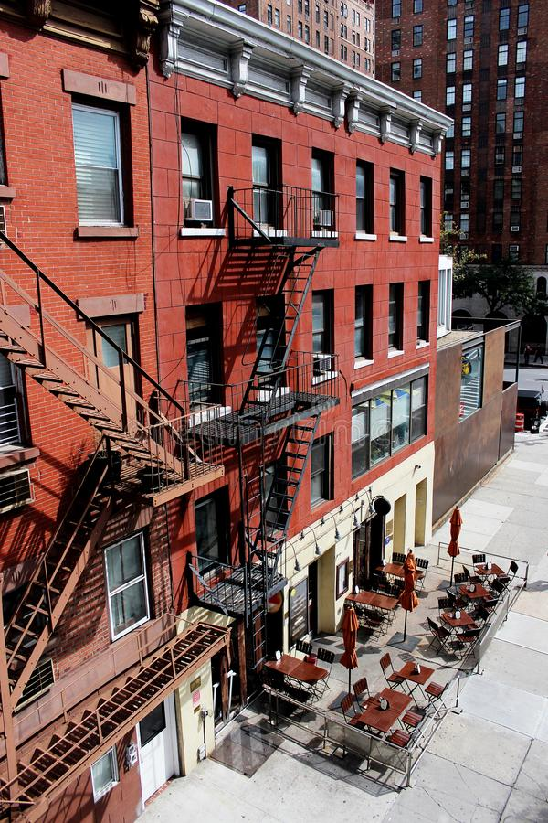 Stairs to exit the fire on the houses of Manhattan. New York City stock photo