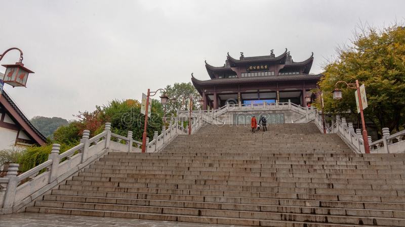 Stairs to a gateway in Wuhan, China. Stairs to a gateway to the Yellow Crane Tower Park in Wuhan, China, on a cloudy November day royalty free stock photos