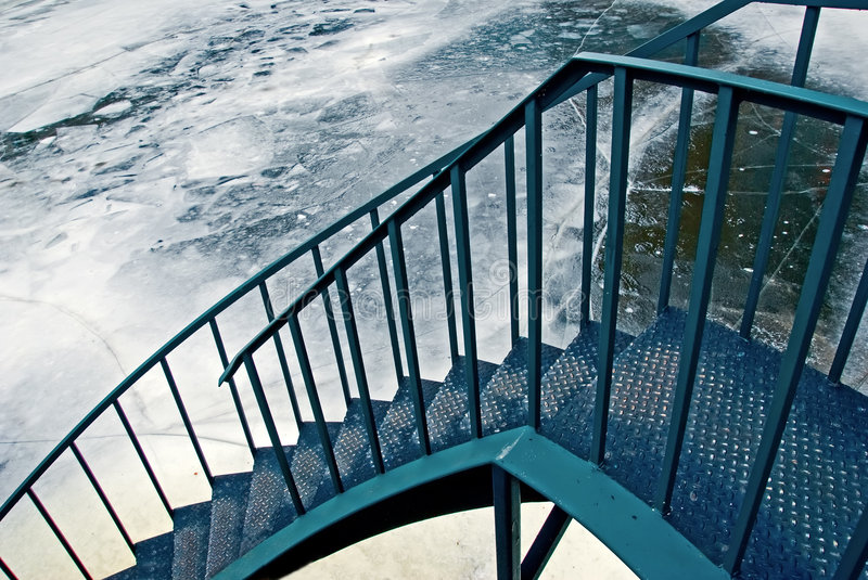 Stairs to the ice-covered river royalty free stock image