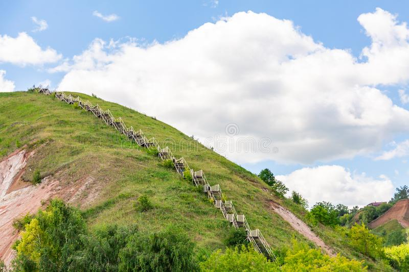 Stairs to the mountain. The hilly Bank of the Volga in Tetyushi, Tatarstan, Russia. Sunny summer day. White clouds in a blue sky stock photo