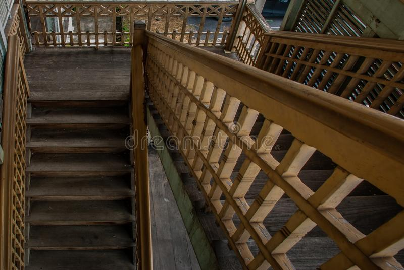 The stairs to the 2nd floor of old city hall, European style building. The vintage white wooden house was left to deteriorate over. Nonthaburi, Thailand - JUL 21 royalty free stock photos
