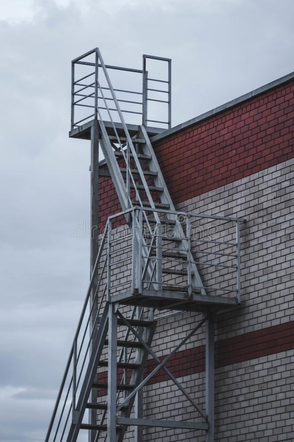 stairs to the roof of a brick building royalty free stock photos
