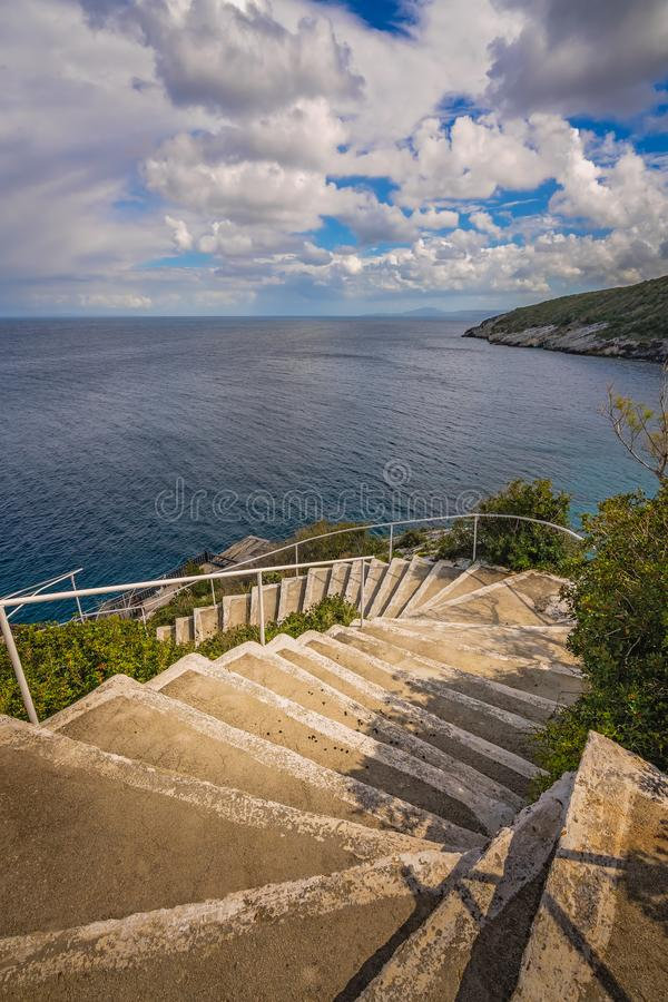 Stairs to the sea in Skinari Cape royalty free stock photos