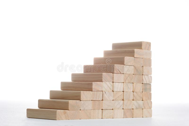 Stairs to success build with wooden blocks on grey background with copy space. Stairs build with wooden blocks on grey background royalty free stock photo