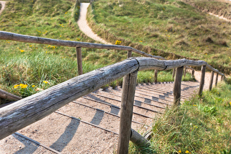 Stairs to the top of a dune.