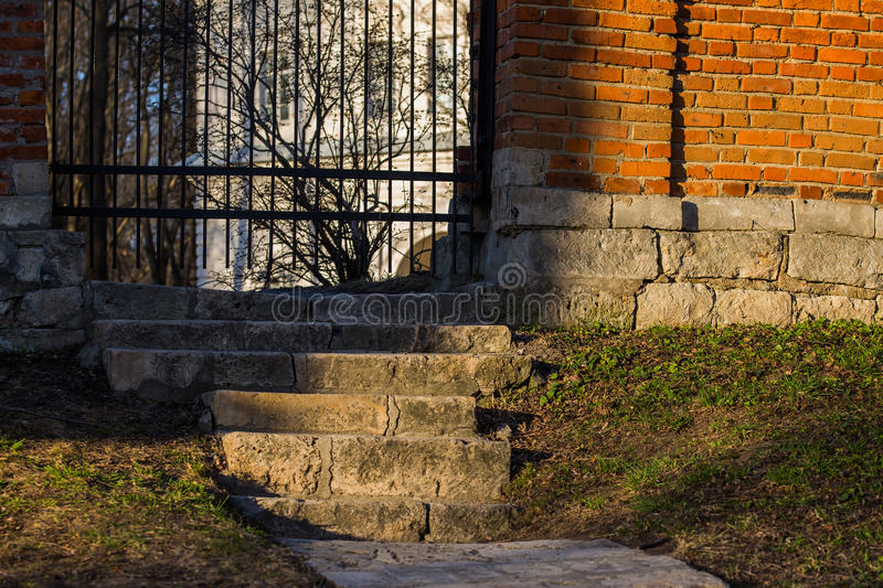 Stairs to wicket in mansion`s brick fence royalty free stock photos
