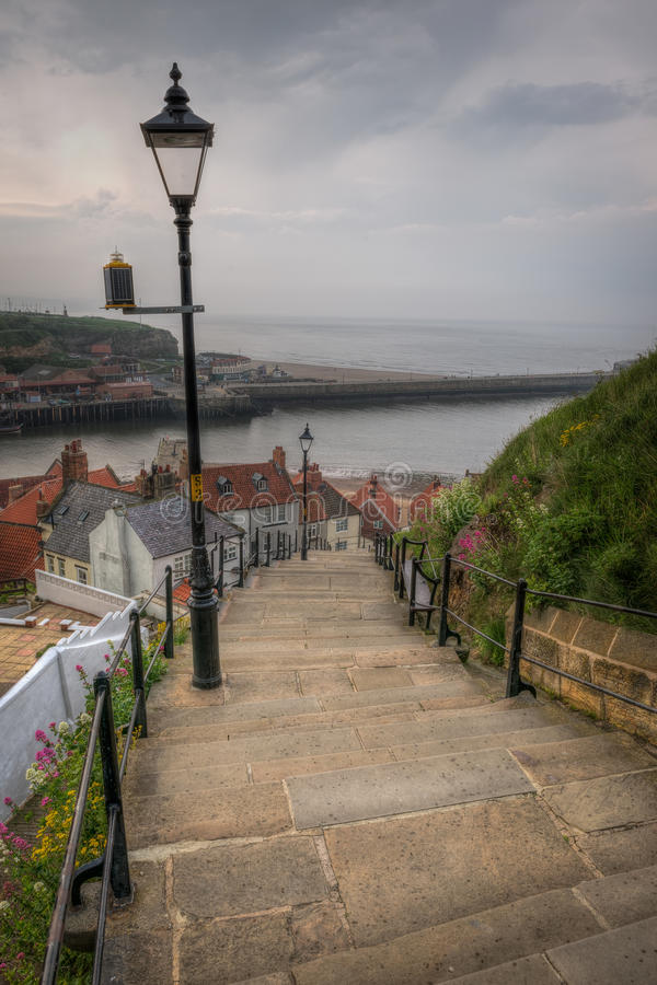 Stairs at Whitby Abbey, England. Whitby Abbey is a ruined Benedictine abbey overlooking the North Sea on the East Cliff above Whitby in North Yorkshire, England stock photos
