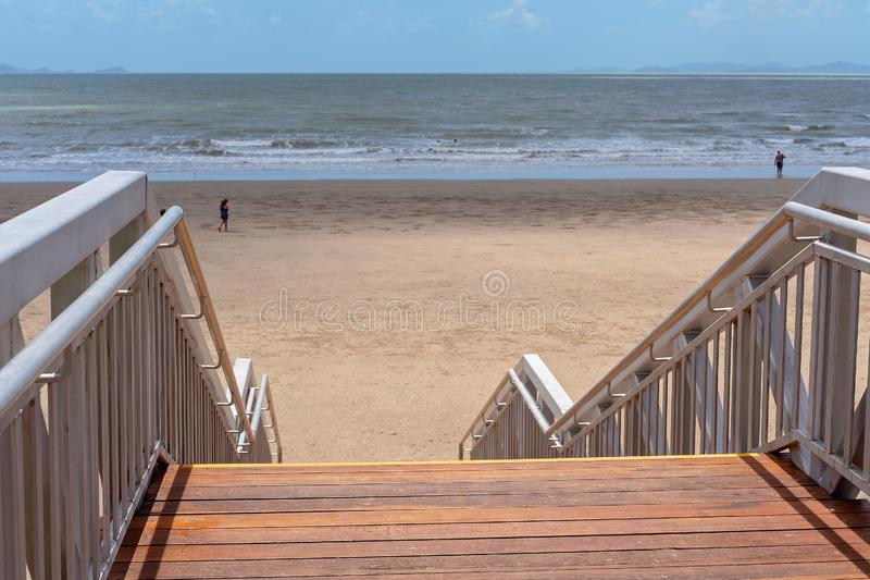 Stairway Access To The Beach. Metal framed timber stairs leading down to the beach on a beautiful sunny day stock photo