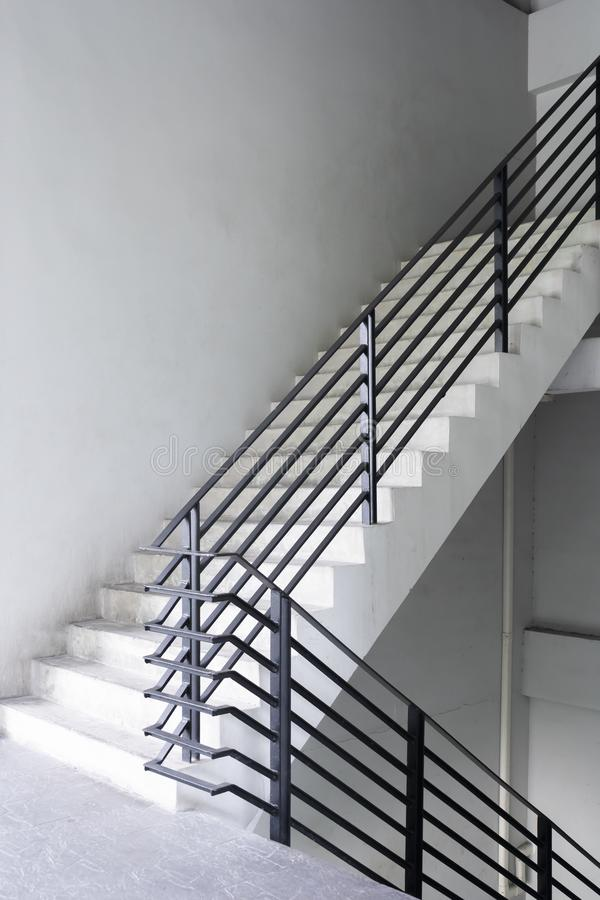 Stairway with black metallic banister modern bulding exterior stock photography