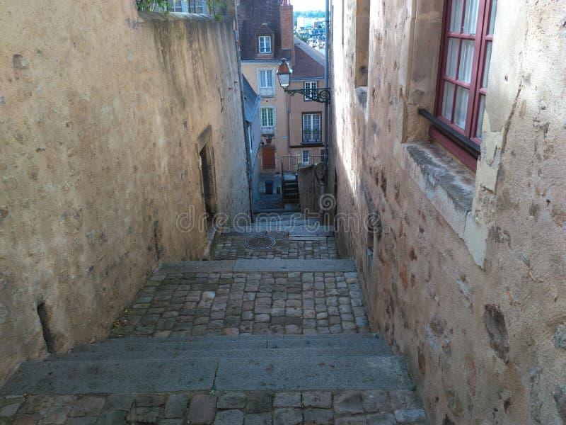 Stairway corridor 4th Century. Path road narrow stone Access lamp Window discretion Wall Masonry Building royalty free stock photos