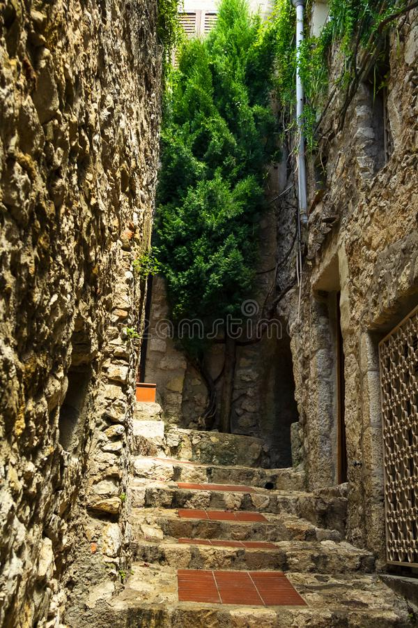Stairway in medieval Eze village at french Riviera coast in Provence, France. Narrow Stairway in medieval Eze village at french Riviera coast near Monaco and stock images