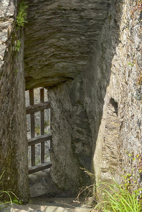 Stairway at Restormel Castle. Restormel Castle Cornish: Kastel Rostorrmel lies by the River Fowey near Lostwithiel in Cornwall, The castle is notable for its stock photos