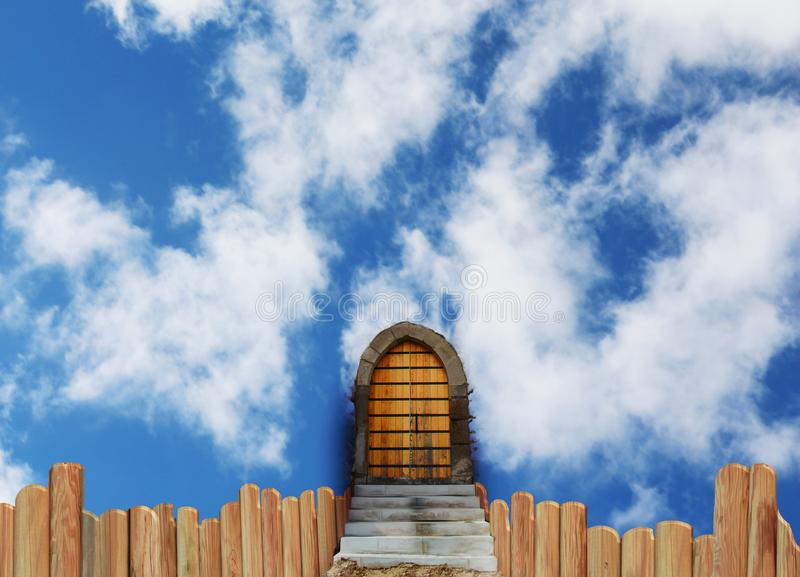 Stairway to Heaven`s Gate. A stairway to heaven`s gate in a blue sky and clouds. there`s a wood fence. the stairs is blocks of stones. *digital art from photos royalty free illustration