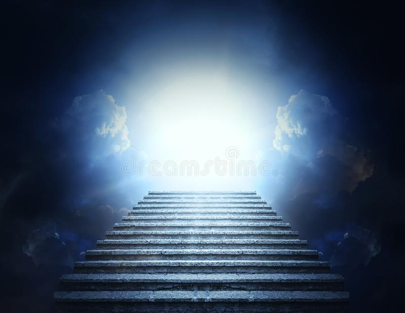 Stone steps into clouds and light. Stairway to Heaven. royalty free stock image