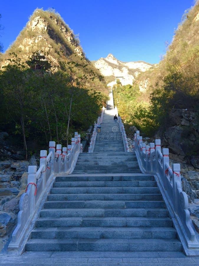 Stairway to the mountain peak. A long stairway, leading up to the mountain peak stock photos