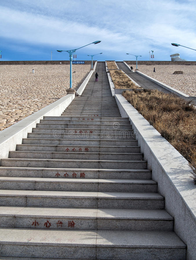 Stairway to the Sky. A long stairway, leading up to a bright blue sky stock image