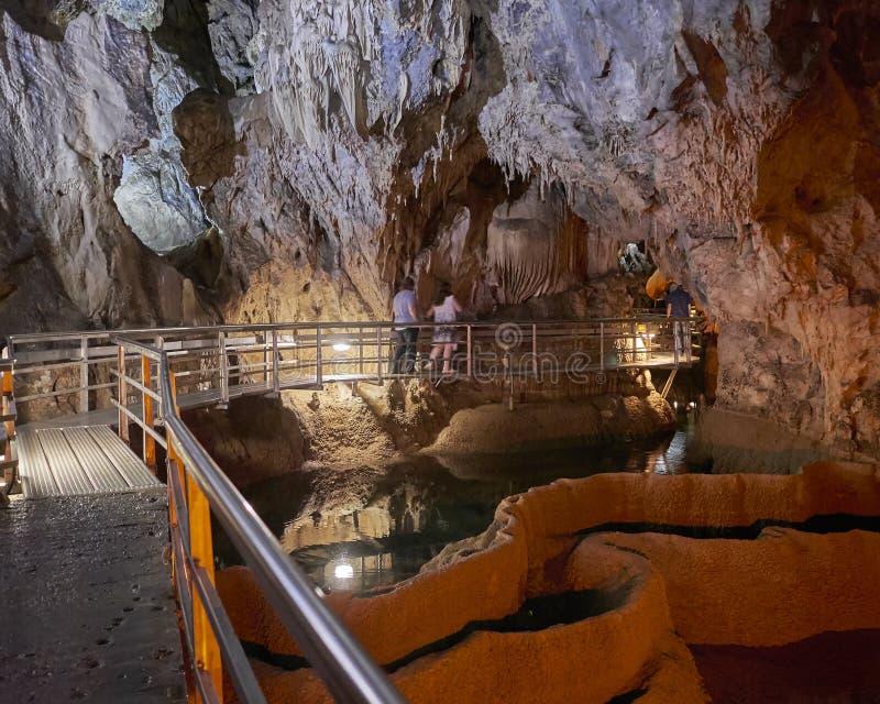 Stairway in underground semi submersed cave stock photo