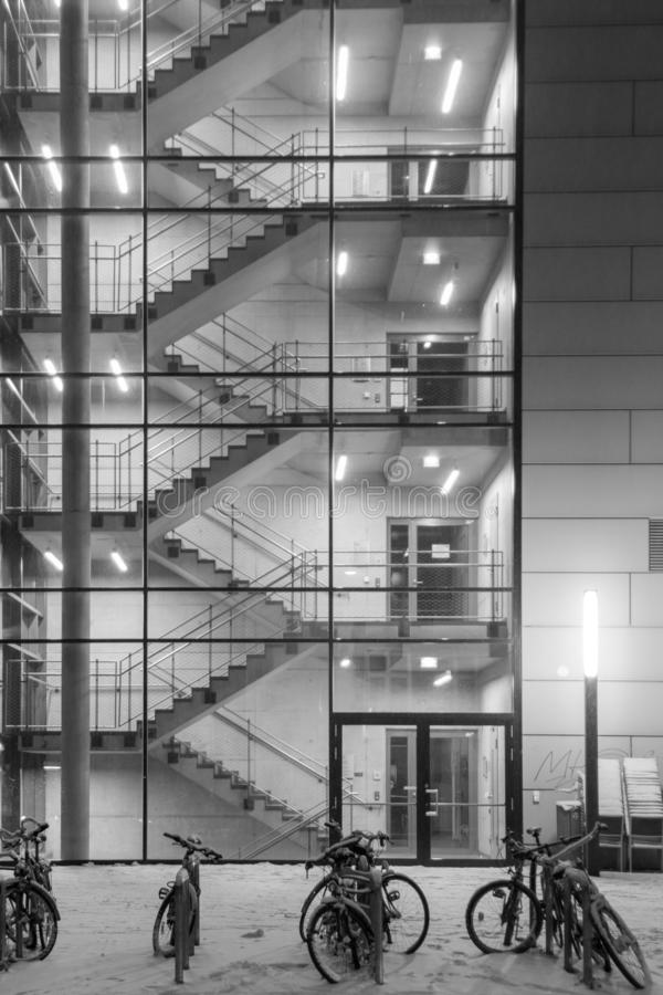 Stairwells behind the transparent glass of the building. Background image. Stairwells behind the transparent glass of the building in winter. Background image stock photography