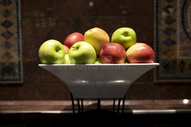 Staked red and green apples in a bowl royalty free stock image