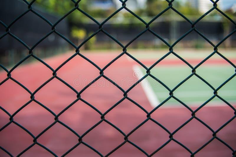 Staket av tennisbanorna royaltyfri bild