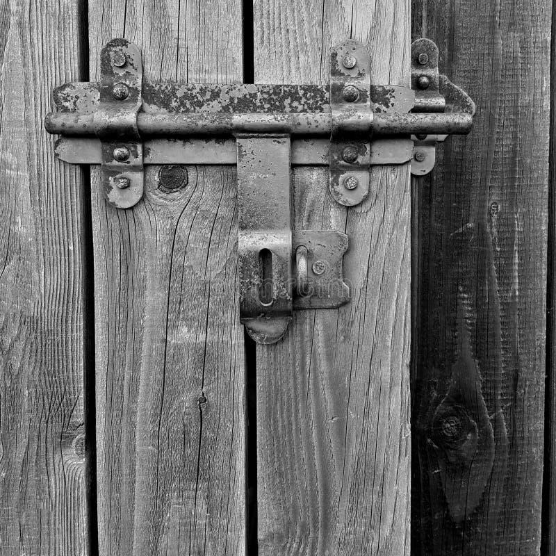 Staldeur het glijden zwart-wit bar/slot detail, close-up royalty-vrije stock foto